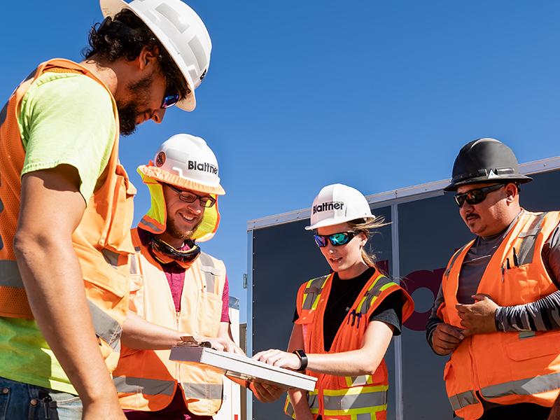 Employees reviewing plan